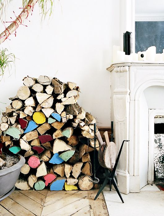 add a pop of color to the fireplace wood pile