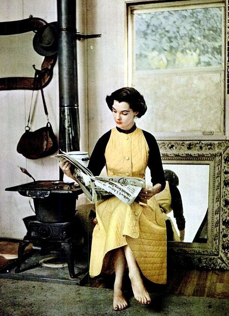 Nan Rees in a quilted housecoat with fitted top that can be worn bare-armed by John Weitz, photo by Milton Greene, 1951. #vintage #1950s #housecoats #fashion