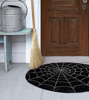52 Halloween Craft Ideas, including this spooky Halloween mat using 1 sq. yard of outdoor carpet -- only about 4 bucks to make..