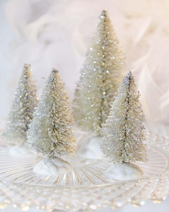 Buy package of green trees...soak in clorox...add glitter...!