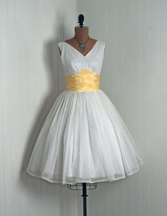 I think this would make a beautiful wedding dress!  Love it.  50's dresses are awesome!