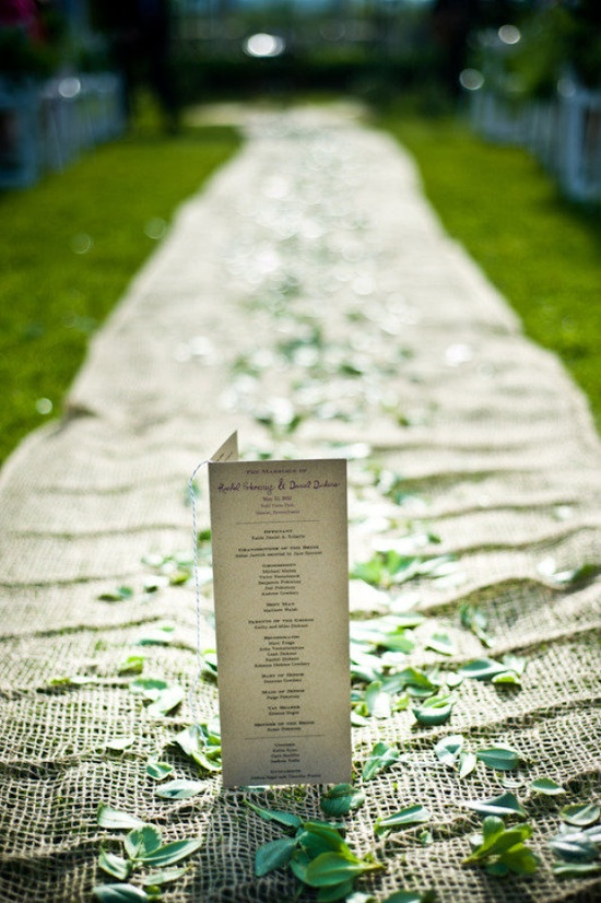 Burlap and leaves make this one earthy aisle not to be missed  Photography by craig-photography...