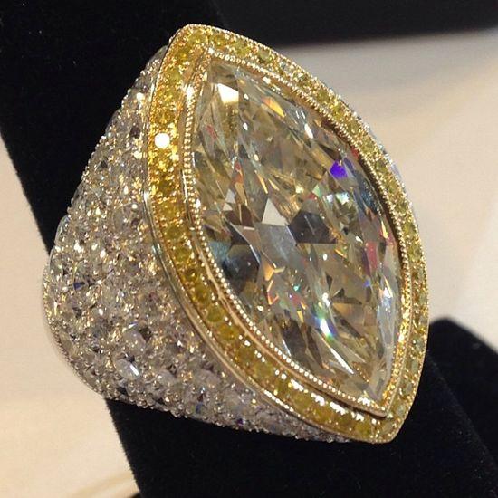 Yellow diamond and white diamond marquise shaped ring