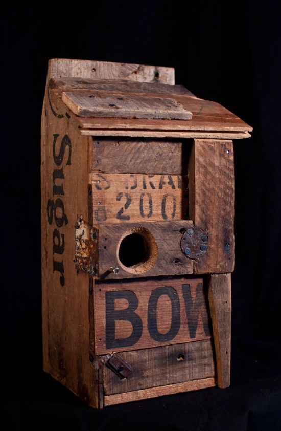 Hand crafted birdhouse made from antique crates and found objects.