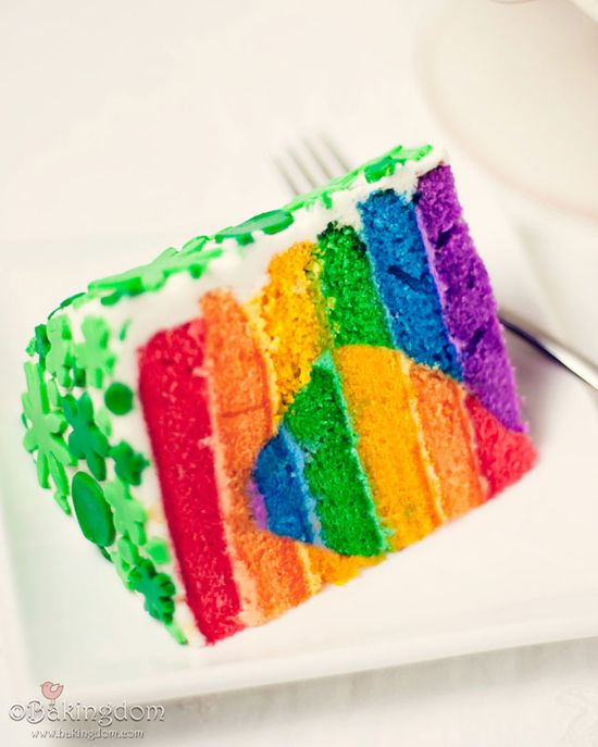 Rainbow-Heart-Cake-Slice Super easy really, just take white cake mix dividing it into smaller bowls and add whatever colors of food dye you want then pour into the cake pan. My sister loved it and I even made rainbow frosting for the top of the cake too