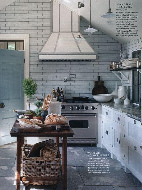 sleek kitchen with organic stone floors #camillestyles #stainlesssteel #marthastewart