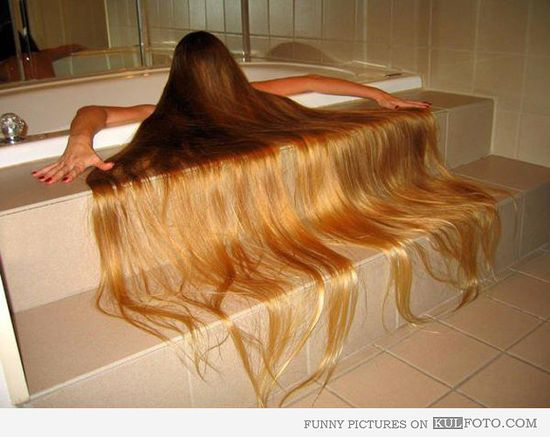 Scary hair bath - Funny girl with really long hair posing in a bathtub like scary girls from Japanese horror movies.