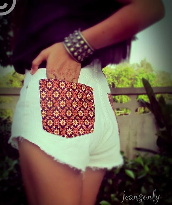Vintage high waisted tribal denim cut off shorts