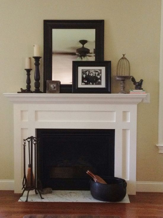 I love the layering of the mirror and picture frame in the middle with similar but not exact anchors on the ends
