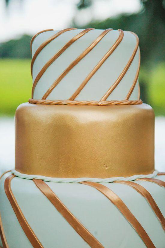 Glam gold and mint wedding cake. #glamcake #gold #weddingcake
