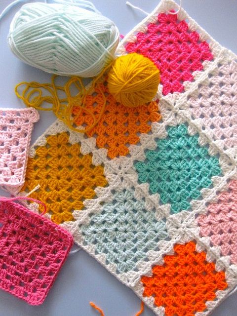 solid granny squares, white borders.