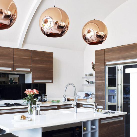 copper pendants, wood cabinets, white countertop, kitchen