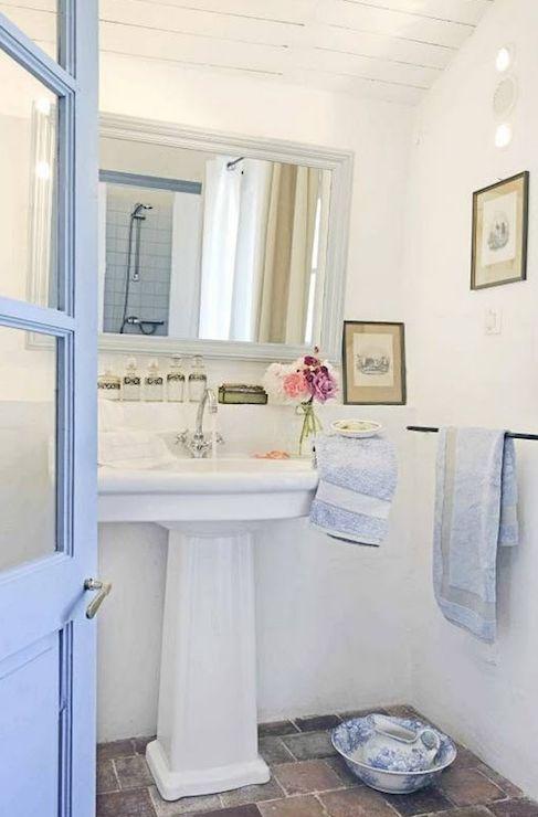 Love this simple bathroom, the beachy blue, stone floors, and white beadboard ceilings.