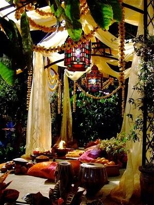 Create a Bohemian feel garden party that goes into night with Stained Glass pendant lamps, draping sheer fabric to define the space, and using colourful pillows to complete the look. looking for rainbows in the moonlight