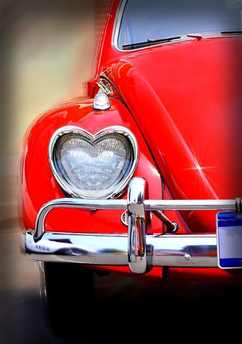 A red car and hearts for lights...