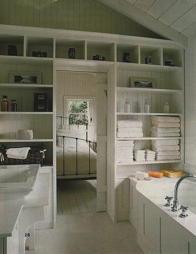 wall of shelves in the bathroom