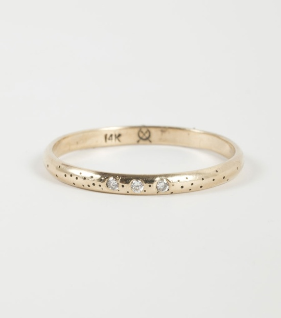 Claire Kinder Studio, speckled band, 14k yellow gold and three white diamonds.