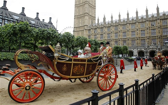 Queen Elizabeth II and Camilla, Duchess of Cornwall, leave Westminster Hall in a horse-drawn carriage