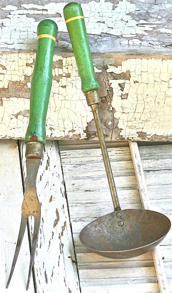 Vintage green-handled kitchen ladle and fork.
