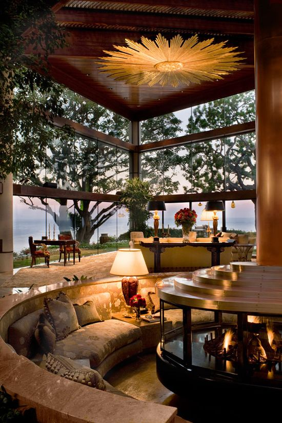 Terrific room with incredible fireplace pit with arched, bench seating. Great design.