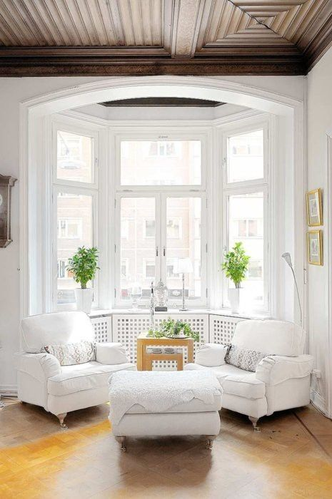 Stunning white room. Love the wood ceiling!