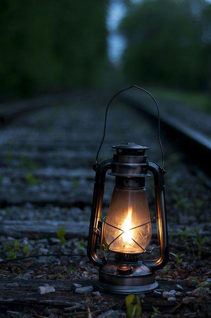 Old lantern on rail road tracks