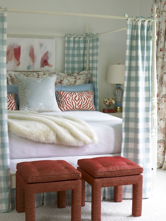 I love the fabric over the canopy bed and the color choices.