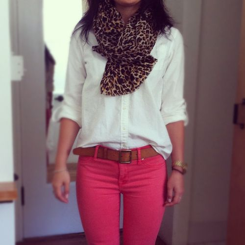 White button-up top, colored skinnies with a belt & animal print scarf.