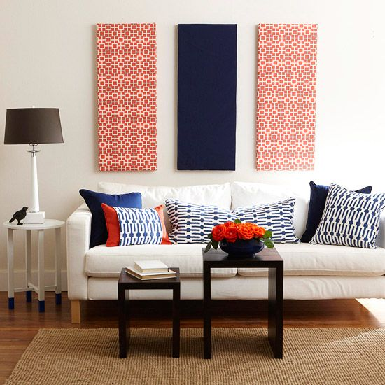 Patterned pillows and wall hangings are a great way to update a living room. More easy fabric updates: www.bhg.com/...