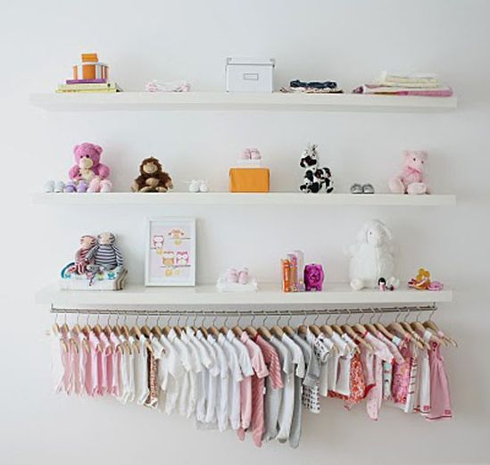 I love the idea of displaying kids clothes. They are too cute!