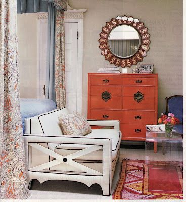 Perfect in the form of an orange chest, blue chair, white couch and Persian rug.