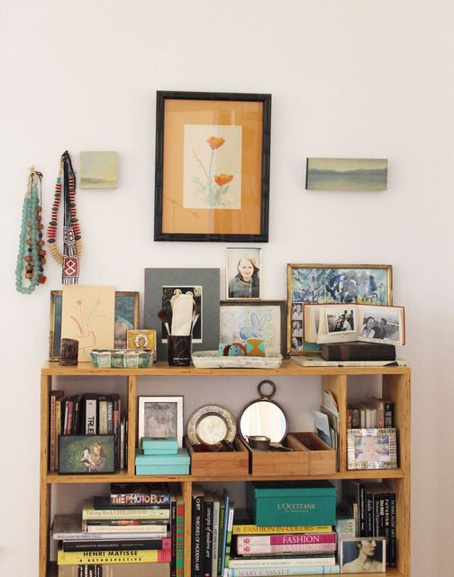 I'm always fascinated with table top objets - love this mix of photos, art, boxes, ceramics and more!!