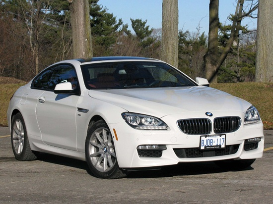 Road Test: 2012 BMW 650i xDrive. Cruising top-down in BMWs 650i Cabriolet is a delightful ride that keyed on sporting comfort. The new Coupe is the Cabs Mr. Hyde  a formidable sports car that actively urges the driver to take liberties