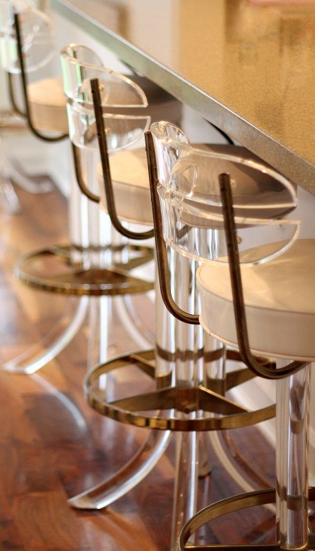 Lucite and brass bar stools.
