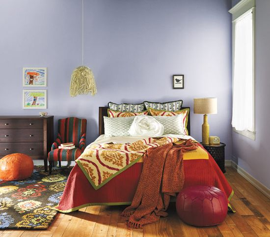 Tips for mixing bright colors and patterns to create an exotic feel in your bedroom.