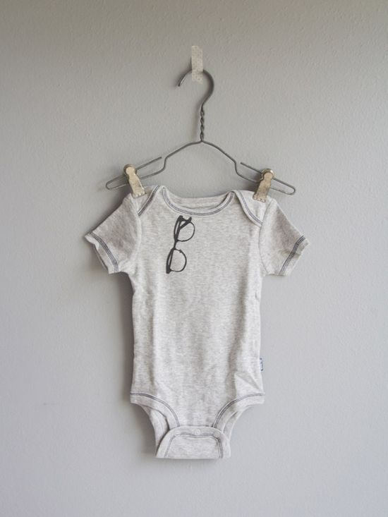 Freezer Paper Baby Boy Onesies. Baby Shower activity that actually yields good-looking onesies.