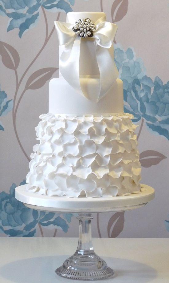 Wedding cake inspired by dress design--I really love that bottom layer! #cake #wedding #white