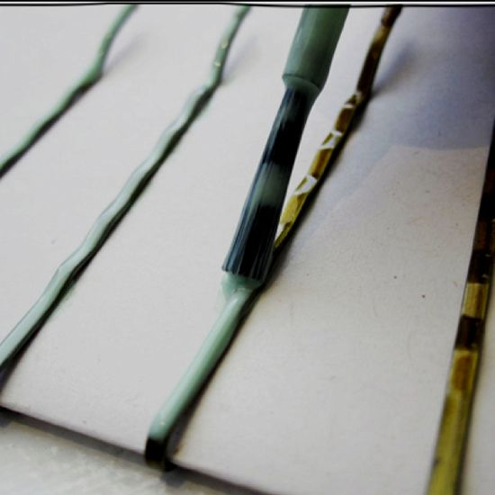 Bobby Pins painted with nail polish.