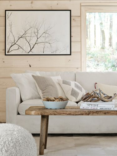 Good idea: An antique pine bench doubles as a coffee table in this living area. (Country Living)