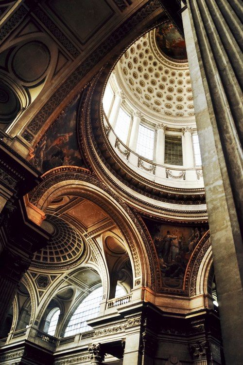 arches dome columns large gradient of light and shadow ornate carvings and decor