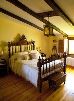 Spanish interior design - antique wooden bed