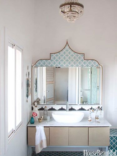 This bathroom in Morocco is both glamorous and functional.