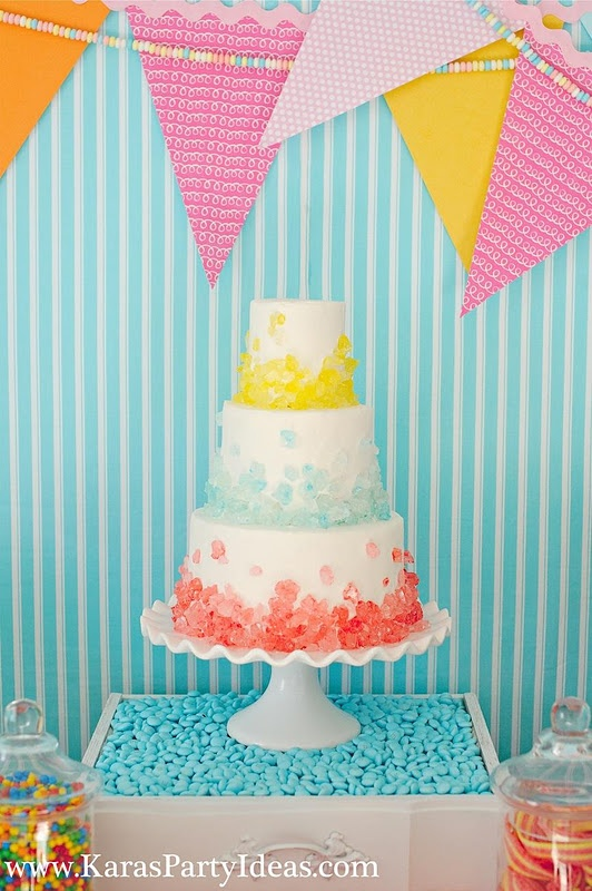 Rock candy pieces on a regular white iced cake. Perfect for a candyland party! #candyland #birthday #party #ideas #rock #candy #sweet #shoppe #cake