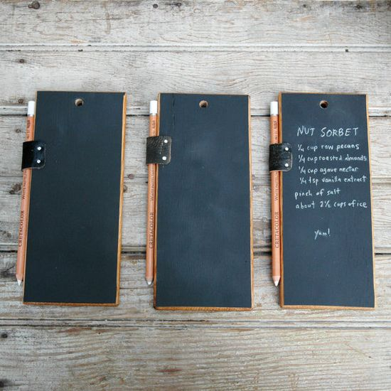 Trio of Chalkboard Tablets...this seems very diy-able. Drill a hole in a rectangular piece of wood, paint it with chalkboard paint, then add a little leather strap to hold a pencil.