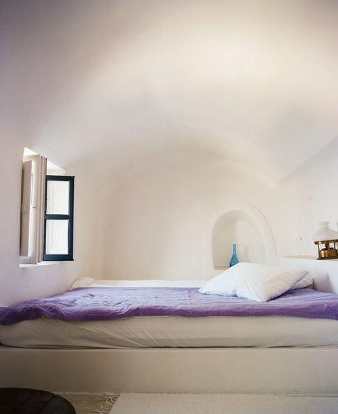 A minimalist guest room at Perivolas resort.