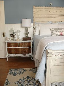 Cottage-style bedroom decorated with cream and blue