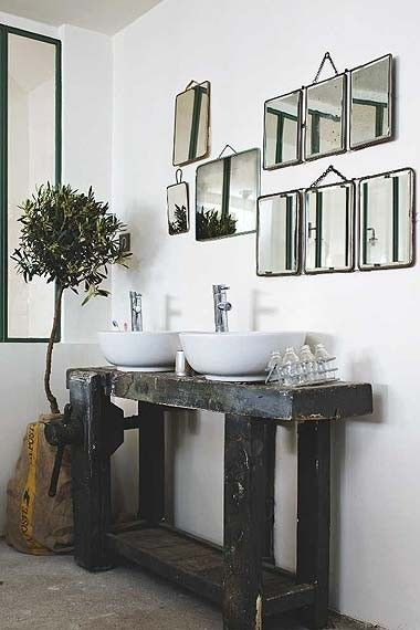 Uber cool bathroom - tree in sack, multiple mirrors, wood bench - just uber cool
