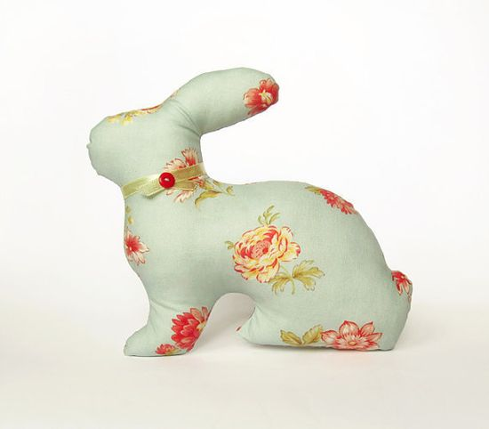 Bunny stuffed animal.  My Grandma made one (maybe two) just like this for me.  She also made a Mama Cat with 3 Kittens and their Blue Kitty Bed.  So pretty.  I would play for hours.  Hmmm, whatever happened to those?
