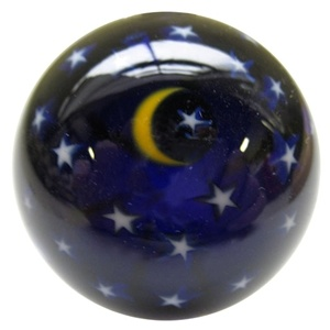 "Moon and Stars - A handmade marble by David Salazar.  This is a signature ""Moon and Stars"" style marble with a very dark blue base, a yellow moon, and white stars.  This one is a bit larger than his typical ""Moon and Stars"" of this size and is loaded with stars.  It is approximately 1 5/8"" in diameter.  It is signed with the artist's initials , DPS, and dated."