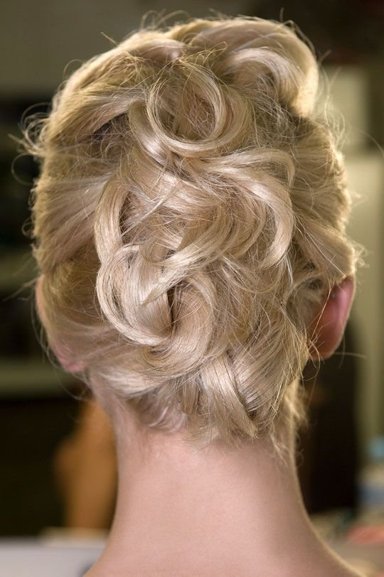 piled up pinned hairstyle